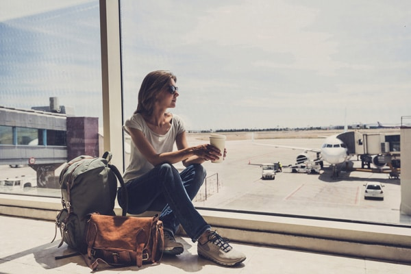 woman alone at airport traveling